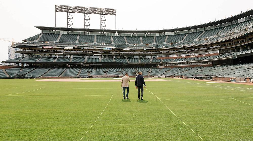 San Francisco Giants pitcher Mark Melancon, right, and his developer Ricardo Santa Cruz walk the floor plan of Mr. Melancon's house in Oracle Park.