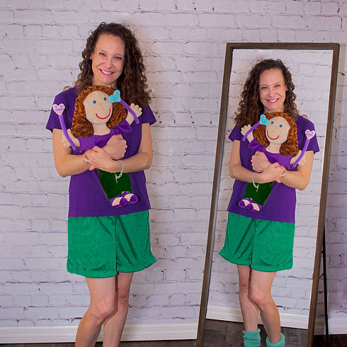 Photo of the author Faith Elicia holding her doll