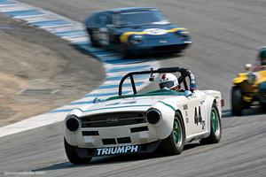"""Ex-Bob Tullius TR6 exiting the """"Corkscrew"""" at Laguna Seca"""