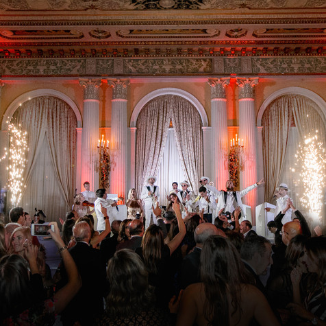 """Eli's Band is legitimately the best wedding band I have ever experienced. I changed my wedding date, which ensured I was able to book them! It was worth it. 2 years later, and I still have guests telling me how incredible my wedding was! They made the party what it was. Every guest was on the dance floor all night long. My friends from afar listen to their youtube videos because their singing is that incredible! They did an amazing job at our friend's wedding, too! BOOK THEM ASAP bc they book out quickly!!!"" - HEATHER & ALEX, Biltmore Hotel DTLA"