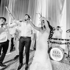 """""""For anyone planning a wedding and looking to hire the BEST of the BEST, look no further!! Eli's Band is hands down the greatest in the business! The most important decision I made was having them at our wedding. My husband and I just celebrated our 1 year anniversary and all of our wedding guests are still talking about our incredible band. Eli and Alisa made our night so perfect in every way. Our ceremony was especially touching during Eli's serenade - he had everyone in tears. On top of this, they are an absolute pleasure to work with. And when they promise you a show, they give you a show!! I truly can not recommend them enough! We love you guys! Thanks for making our dream wedding!"""" - REBECCA & SHAI - Biltmore Hotel, Phoenix AZ"""