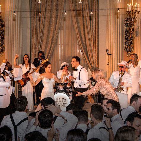 """My husband and I got married in January and we had Eli's Band play for both the ceremony and the reception. They were absolutely incredible!! We had a multicultural wedding and needed music from so many genres (Spanish, Arabic, orthodox Jewish, modern Israeli and English music) and they seamlessly transitioned through them all. Our guests were absolutely blown away!! We obviously knew Eli and Alisa were awesome when we hired them but I can't tell you how grateful we are for the incredible party they kept going all night. They know their crowd and knew exactly what to play and when. For the ceremony, Eli sang a mix of original songs he wrote and songs we had requested. His voice captivates the room and created something truly special for us. Everyone had goosebumps. Everyone at the party LOVED our band and some of our friends have even booked them already for their own events. Can't wait to be invited to a party they're performing at!"" - STEPHANIE & ELIOTT - Biltmore Hotel, Downtown LA"