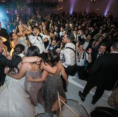 """""""Eli's Band is THE ABSOLUTE BEST!! We hired the band for our New Year's Eve wedding and they were a HIT!! Everything from the live music while I (the bride) walked down the aisle, to playing with the band and keeping the crowd dancing ALL night, was amazing. Our wedding would NOT have been the same without Eli's Band. Alisa helped us tailor every single song for our wedding and also helped keep me calm before I walked down the aisle. She even helped us design the stage for the wedding and lighting! She was my rock throughout the wedding planning process. I only have good things to say about them. Eli's band MADE my wedding and the wedding-planning experience."""" - JOSEPHINE & AARON - Monarch Beach Resort, Dana Point OC"""