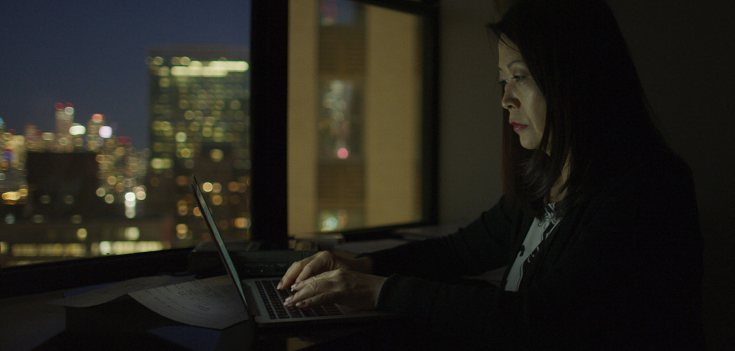 Akiko Mikamo works on 8:15 in New York City with the United Nations in the distance.