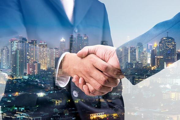 Double exposure of business handshake fo
