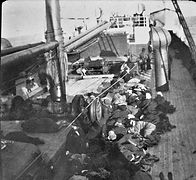 Steerage passengers on the deck of S. S. Numidian in 1900