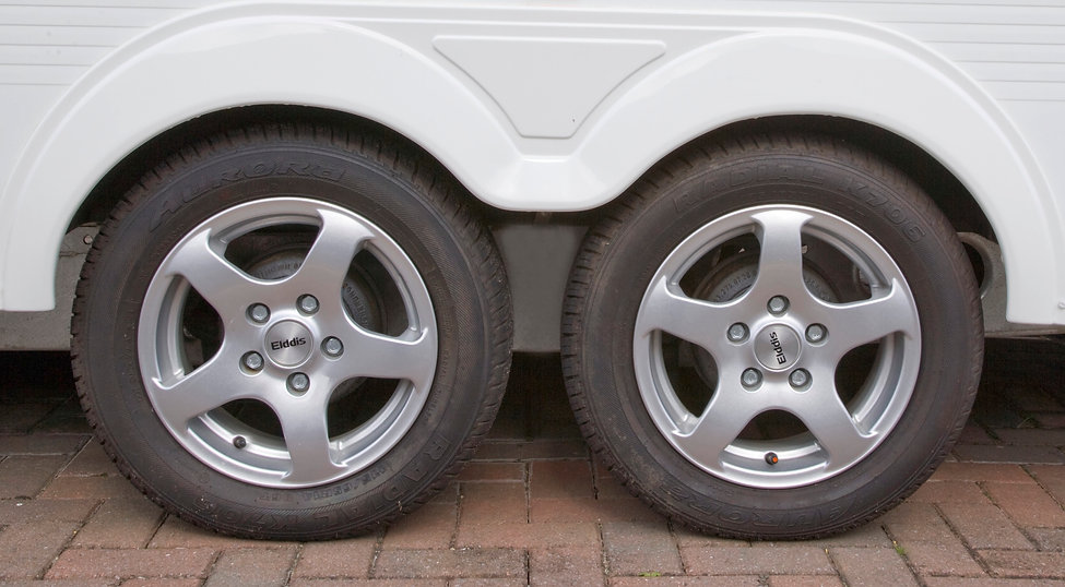 BOO-279 2 caravan wheels on soft.jpg