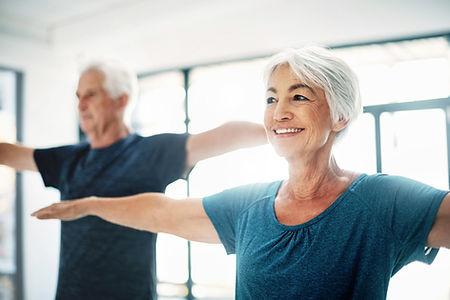 Elderly Couple Practising Yoga_edited.jpg