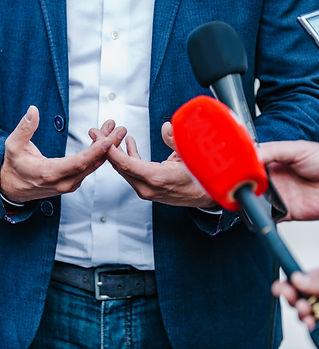 interviewing-businessman-on-press-confer