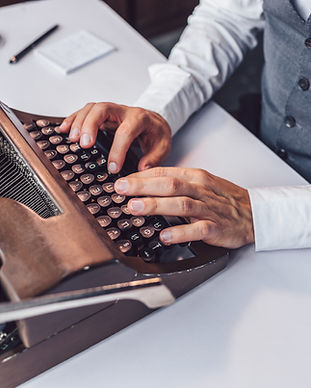 male-hands-typing-on-a-retro-typewriter-