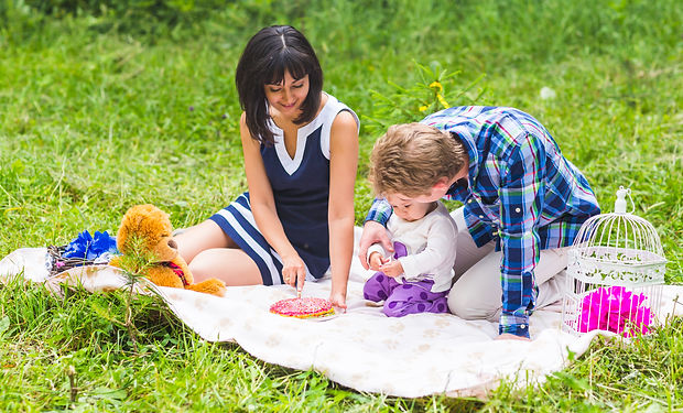 happy-mixed-race-family-having-a-picnic-