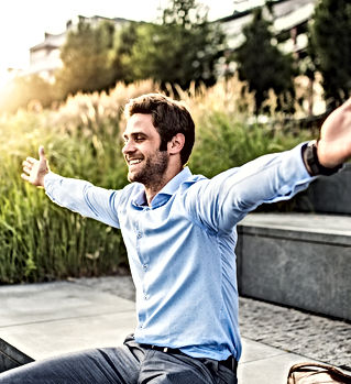 a-happy-young-businessman-with-arms-stre