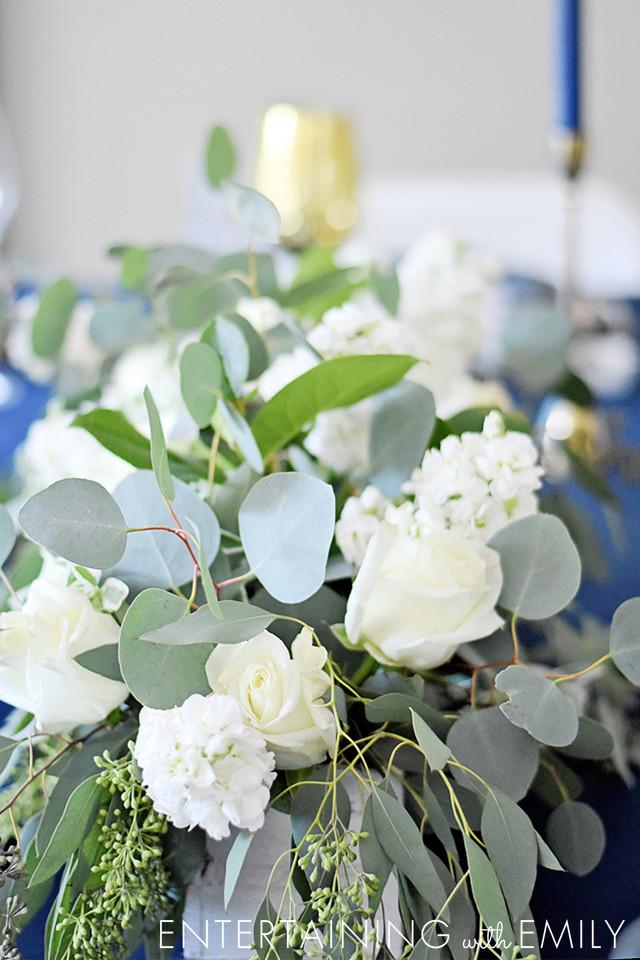 floral centerpieces - white hydrangeas, eucalyptus, white roses