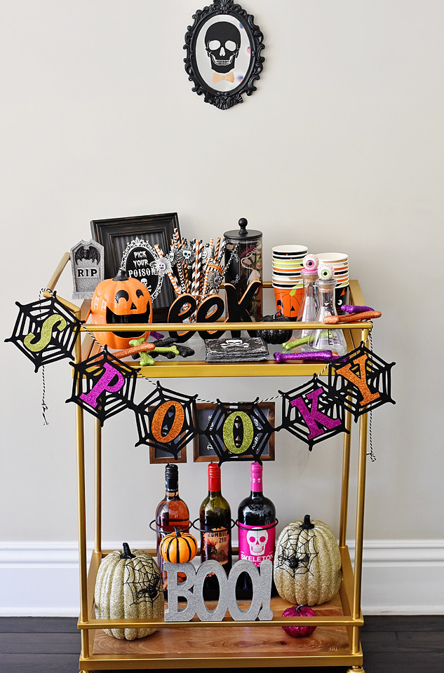 a spook-tastic bar cart to entertain your guests on Halloween!