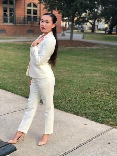 Evelyn Nguyen white suit.jpeg