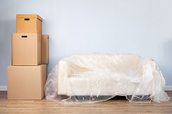 packed-household-stuff-boxes-packed-sofa