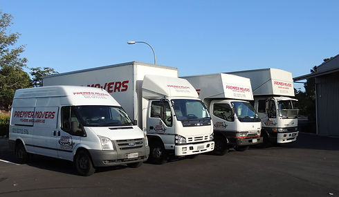 premier-movers-trucks-parked-in-yard.jpg