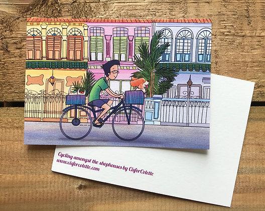 Cycling amongst the shophouses postcard