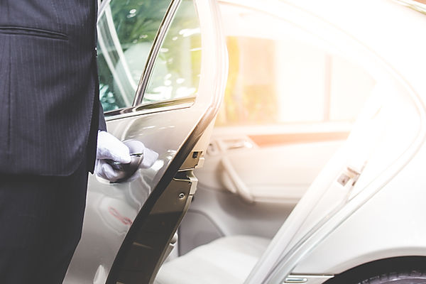 Closeup of chauffeur opening car door.jp