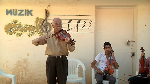 AmalsGarden_filmstill3_violin.jpg