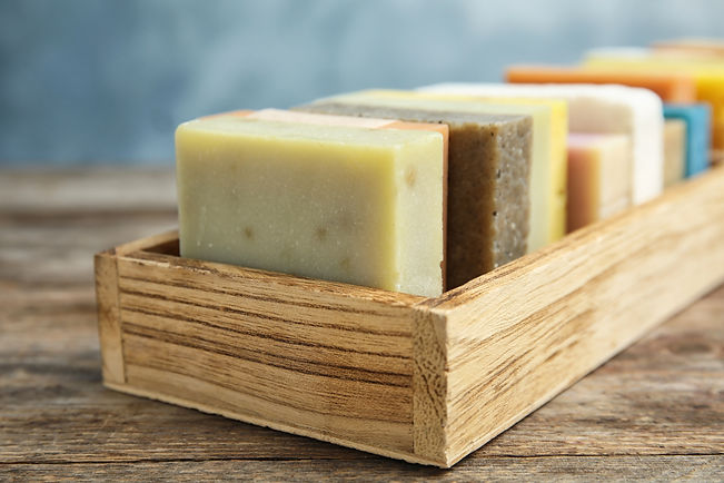Many different handmade soap bars in woo