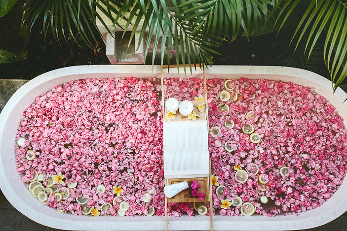 Top view of bath tub with flower petals
