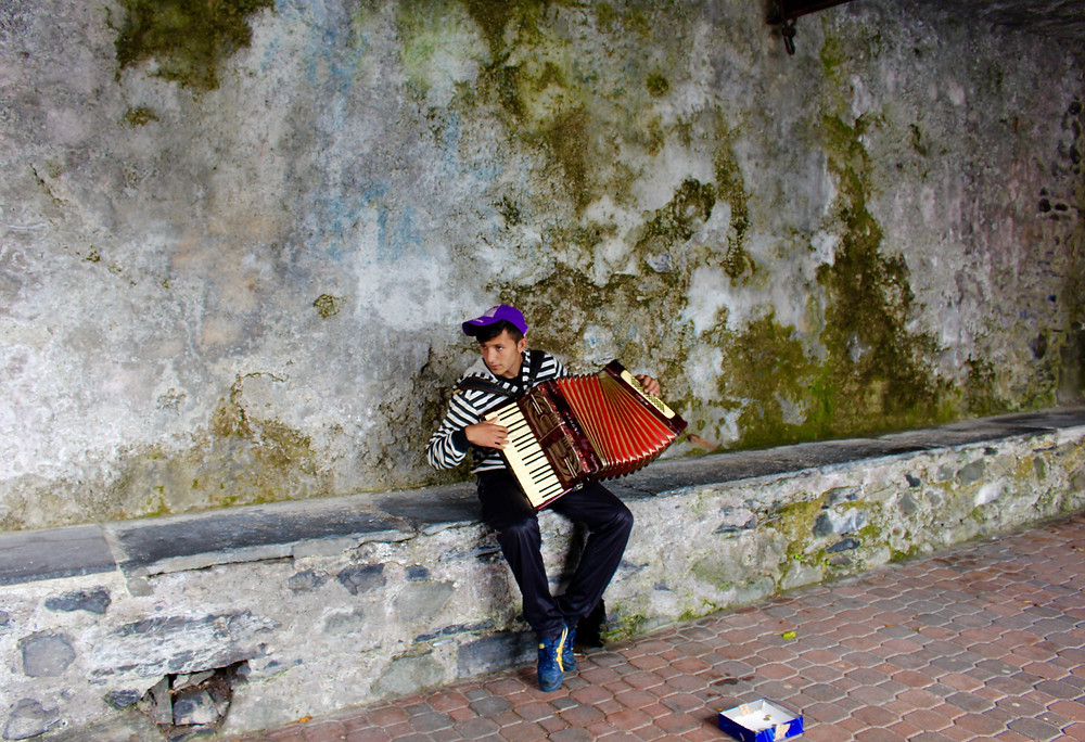 This artist played his melancholy accordian in a street alcove on a street in Varenna, Italy for change day after day during my visit.   He moved my heart.