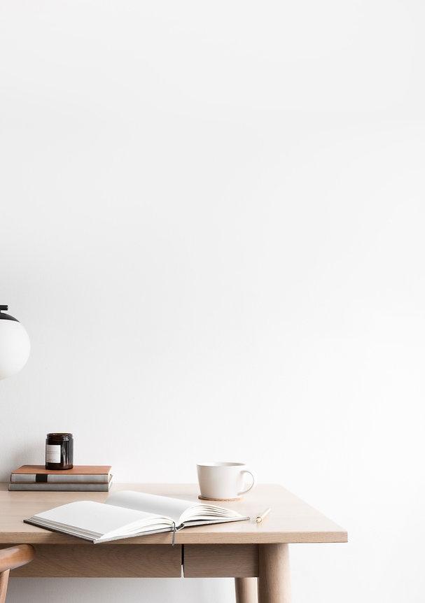 Minimal desk set up with notebook and coffee mug by lugi design studio branding and website design