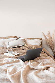 Nude-beige-tones-laptoon-on-bed-lugi-des