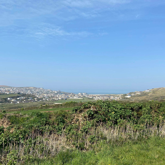 Standing right on the edge of the front field looking down on pretty Perranporth