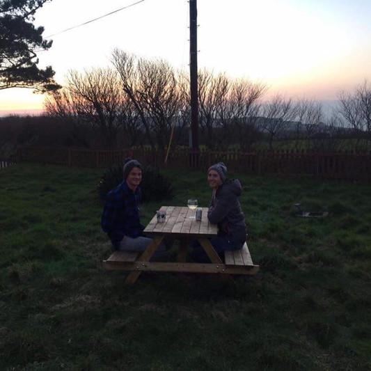 Enjoying an evening drink and a winter sunset