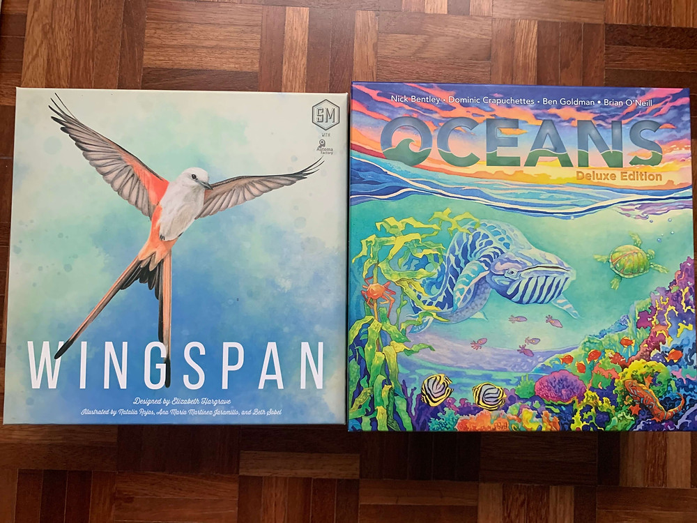 Two board games side by side - Wingspan (Left) and Oceans (Right)