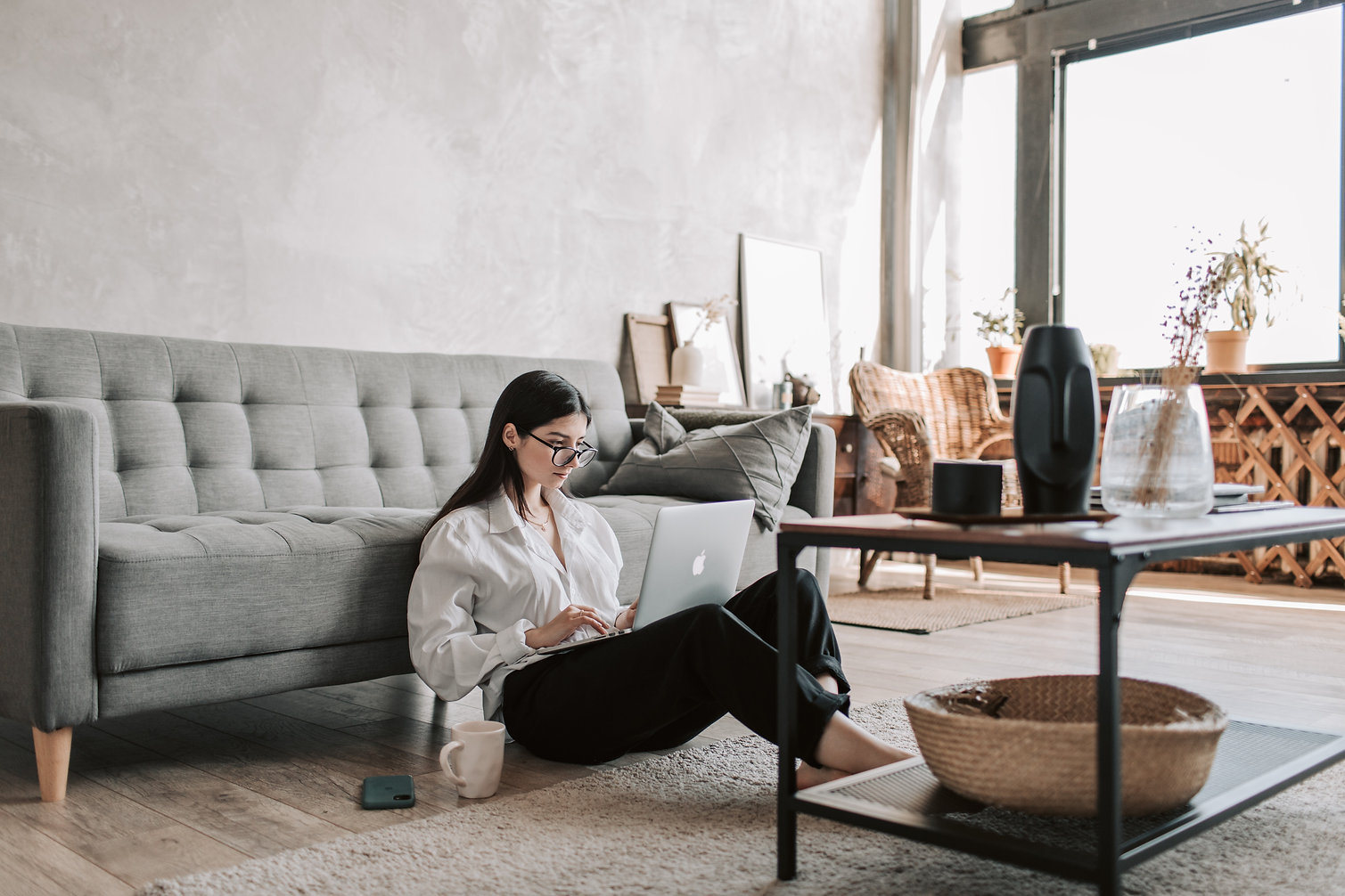 woman-sitting-on-the-floor-while-using-h