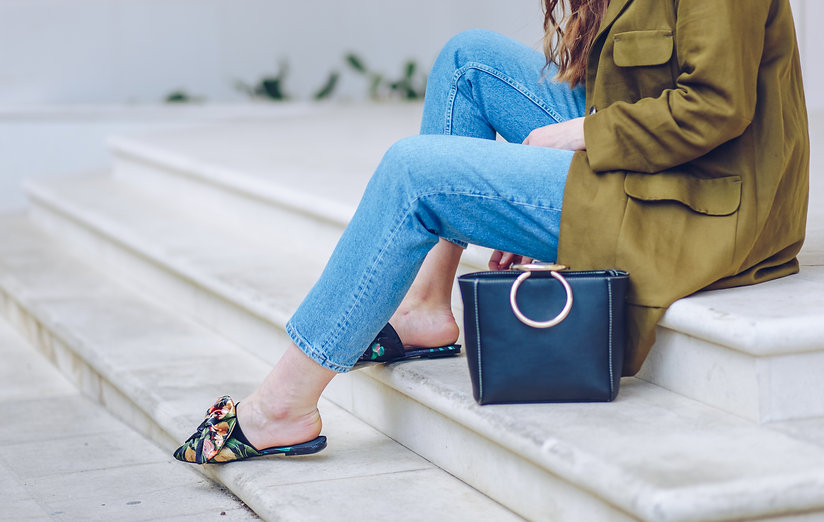 spring/summer outfit fashion details, young stylish woman wearing denim jeans, black handb