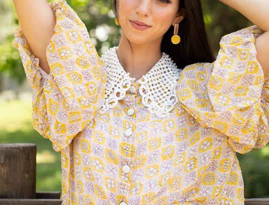 Yellow pearls shirt