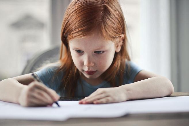 girl-writing-on-paper-1843358.jpg