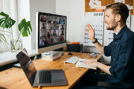 a man working from home, using MS Teams to collaborate