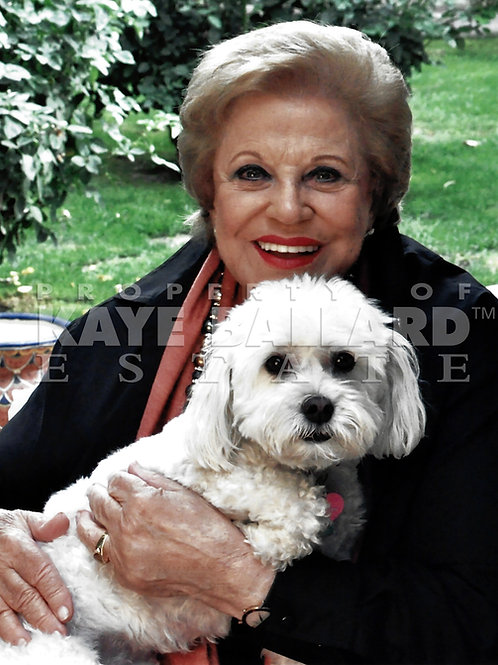 Kaye outdoors with one of her puppies