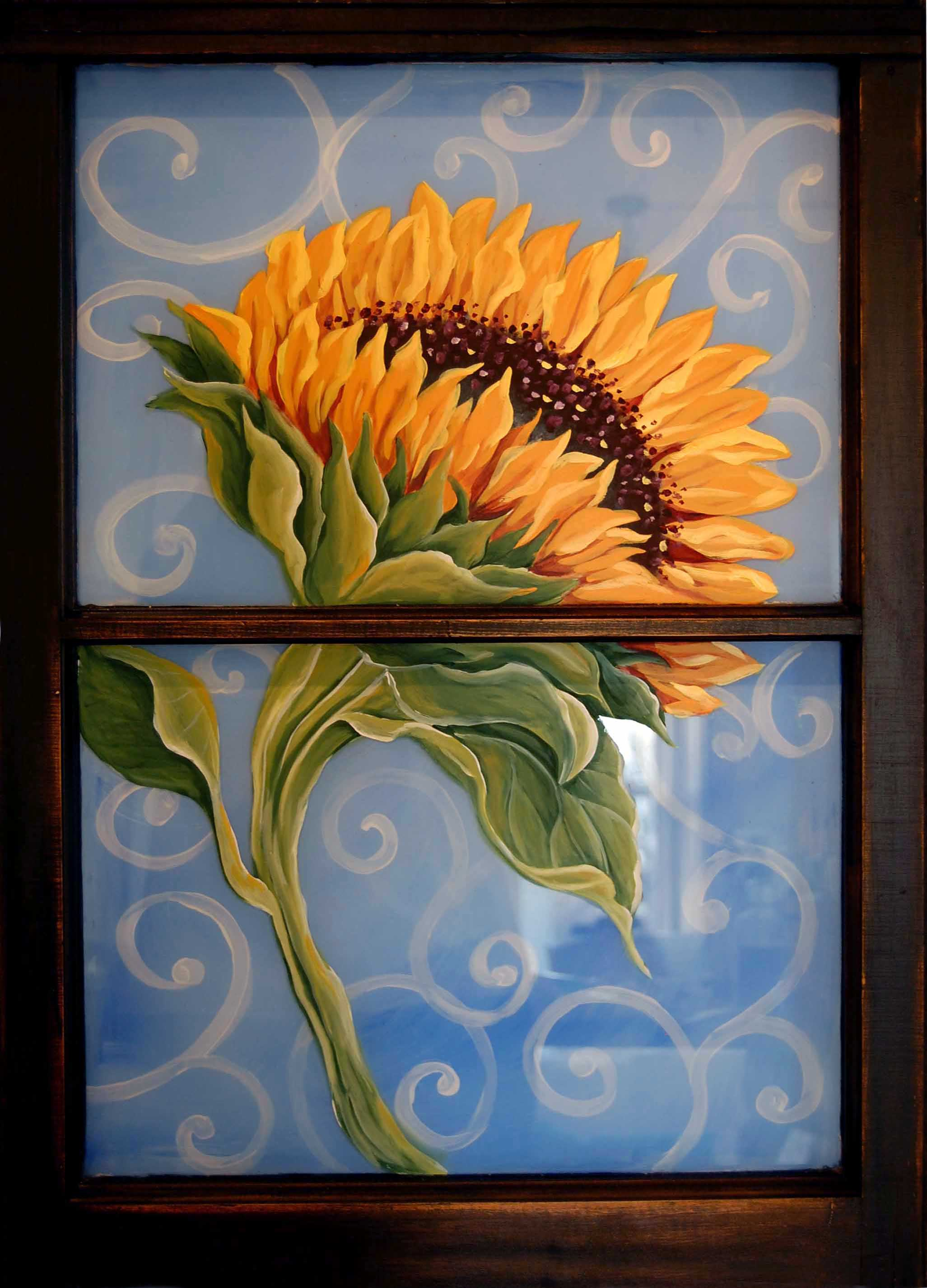 Sunflower on old window