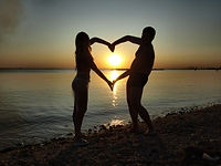couple-on-beach-making-heart-shape.jpg