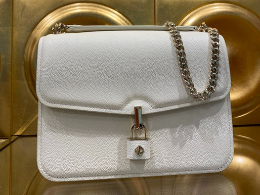 The Truth About Your Favorite Brand Name Purses.