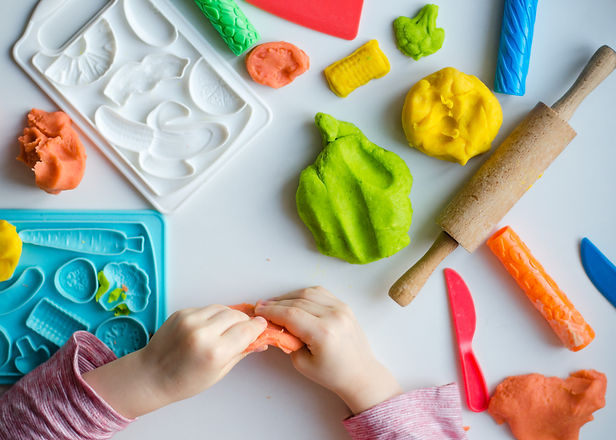Child's hands with colorful clay. Child