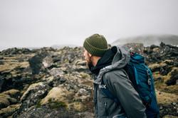 Young man in hiking trekking gear, water