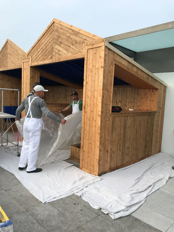 Outside huts before painting.jpg