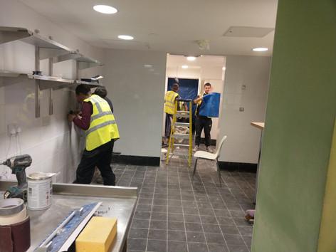 4 workmen industrial kitchen.jpg