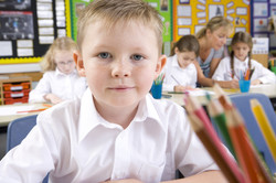 School boy sitting in classroom