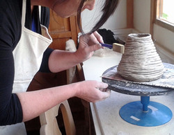Applying coloured slip to a coiled pot