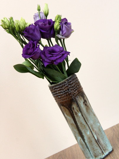 Tall slim intricate vase, black clay, ha
