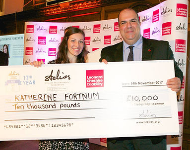 Katherine Fortnum and Stelios Haji Louanna, receiving cheque at Stelios Award for disabled entrepreneurs 2017