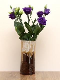 Tall intricate vase, ice chocolate, ston